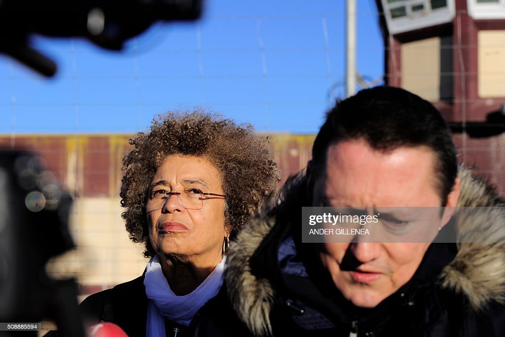 US political activist Angela Yvonne Davis (L) stands next to Basque musician Fermin Muguruza outside the 'Centro Penitenciario de Logrono' prison, after her vain attempt to visit the imprisoned leader of the Basque Patriotic Left movement Arnaldo Otegi on February 7, 2016 in the northern Spanish city of Logrono. Although Angela Davis had received the permission to visit Otegi, the prison of Logrono finally denied it. Arnaldo Otegi is imprisoned since 2009 and will be released on March 1, 2016. AFP PHOTO / ANDER GILLENEA / AFP / ANDER GILLENEA