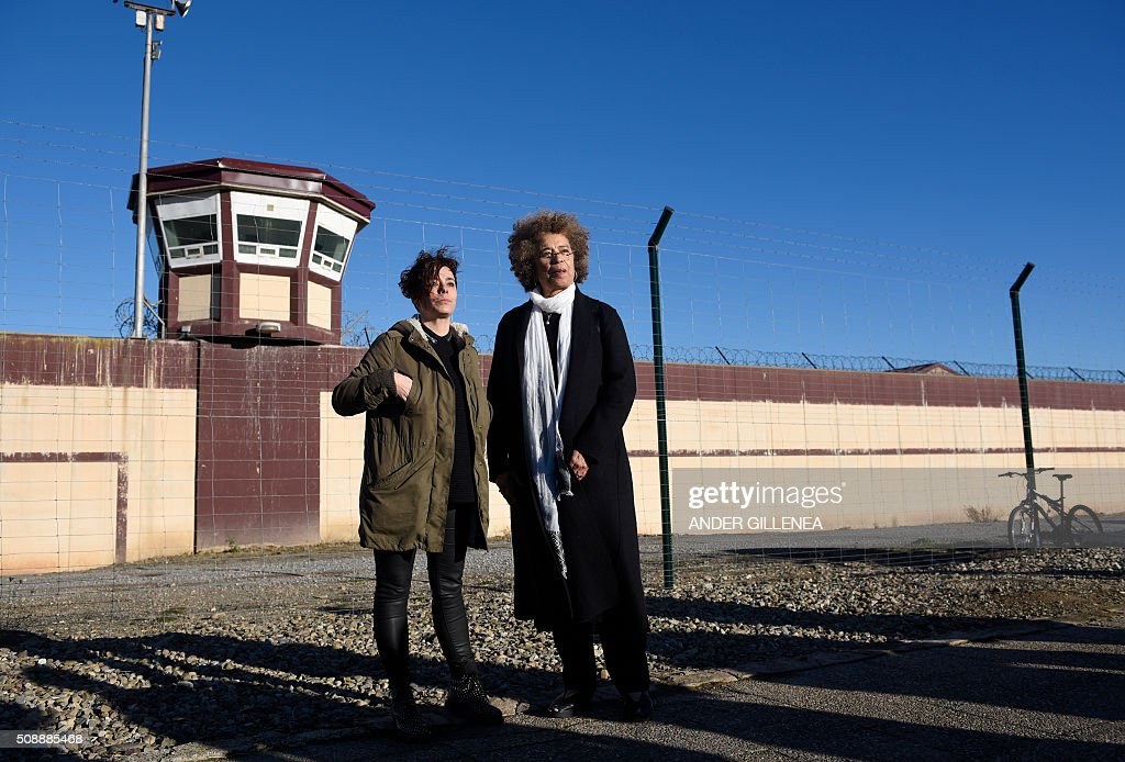 US political activist Angela Yvonne Davis (R) stands next to SORTU Basque political party representative Amaia Izko outside the 'Centro Penitenciario de Logrono' prison, after vainly attempt to visit the imprisoned leader of the Basque Patriotic Left movement Arnaldo Otegi on February 7, 2016 in the northern Spanish city of Logrono. Although Angela Davis had received the permission to visit Otegi, the prison of Logrono finally denied it. Arnaldo Otegi is imprisoned since 2009 and will be released on March 1, 2016. AFP PHOTO / ANDER GILLENEA Basque socialist political party Sortu's member (L) / AFP / ANDER GILLENEA