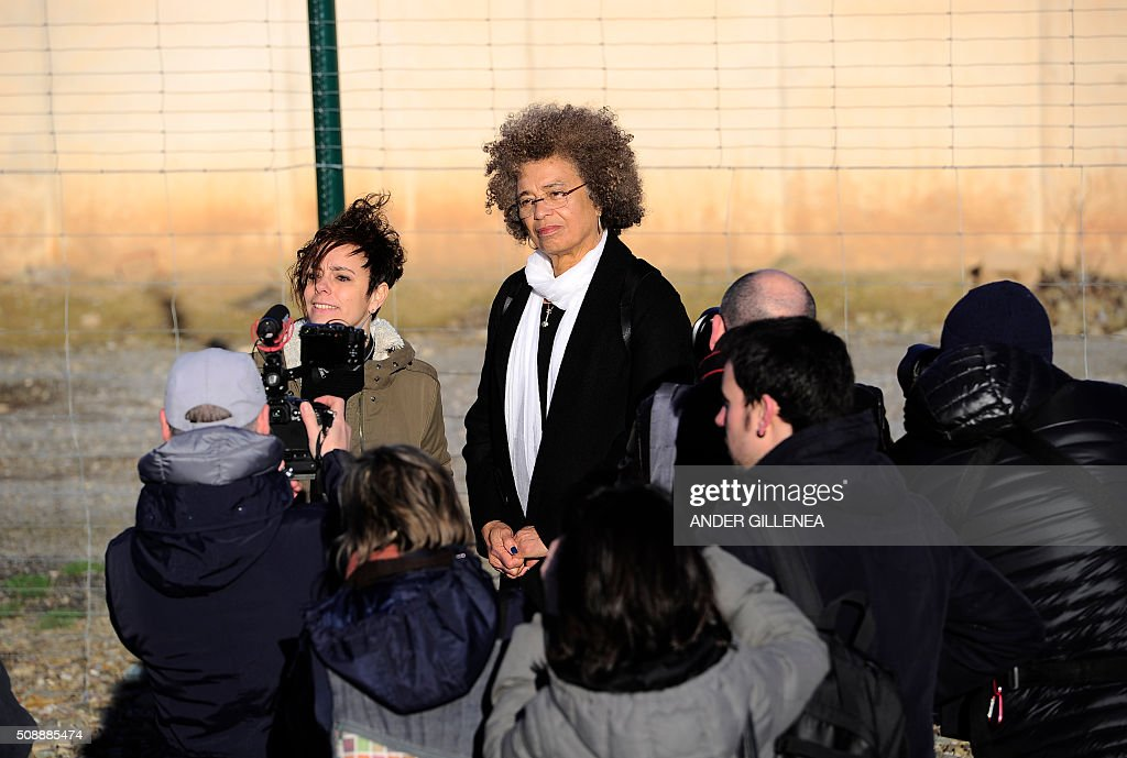 US political activist Angela Yvonne Davis (R) stands next to SORTU Basque political party representative Amaia Izko outside the 'Centro Penitenciario de Logrono' prison, after vainly attempt to visit the imprisoned leader of the Basque Patriotic Left movement Arnaldo Otegi on February 7, 2016 in the northern Spanish city of Logrono. Although Angela Davis had received the permission to visit Otegi, the prison of Logrono finally denied it. Arnaldo Otegi is imprisoned since 2009 and will be released on March 1, 2016. AFP PHOTO / ANDER GILLENEA GILLENEA