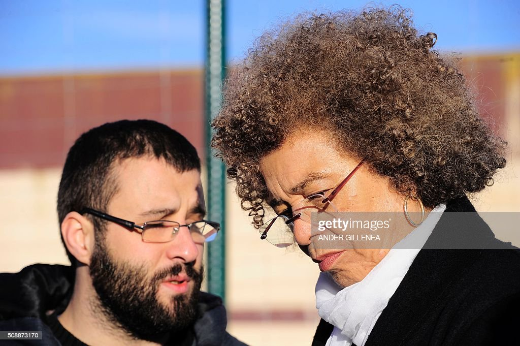 US political activist Angela Yvonne Davis (R) stands outside the 'Centro Penitenciario de Logrono' prison after her attempt to visit the imprisoned leader of the Basque Patriotic Left movement Arnaldo Otegi on February 7, 2016, in the northern Spanish city of Logrono. Although Angela Davis had received the permission to visit Arnaldo Otegi, the prison of Logrono finally denied it. Arnaldo Otegi is imprisoned since 2009 and will be released on March 1, 2016. AFP PHOTO / ANDER GILLENEA / AFP / ANDER GILLENEA