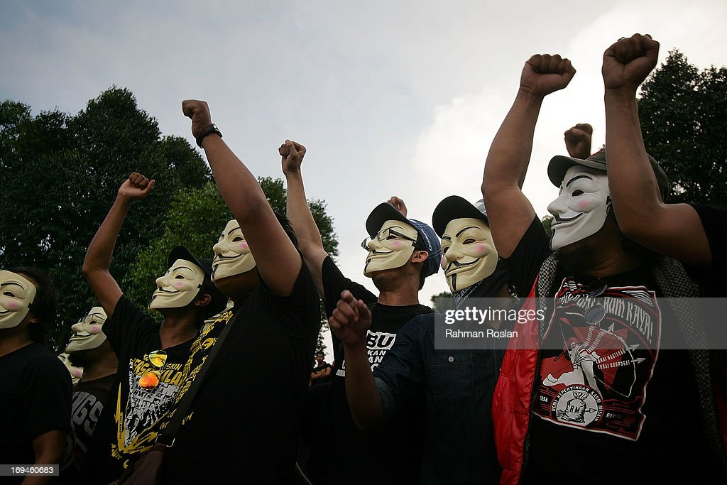 Political activists wear anonymous masks during a political rally against election fraud on May 25, 2013 in Kuala Lumpur, Malaysia. Thousands of supporters of Pakatan Rakyat (People's Pact/People's Alliance) gathered to voice their dissatisfaction over alleged election fraud in Malaysia's 13th General election result.