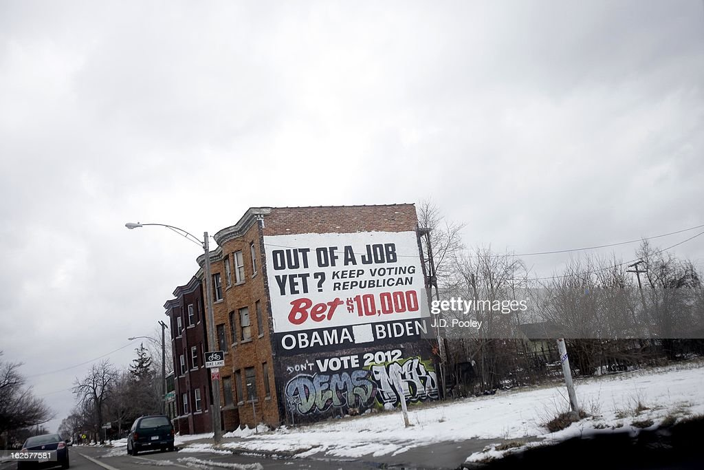 A political ad covers the side of a building February 24, 2013 in Detroit, Michigan. The city of Detroit has faced serious economic challenges in the past decade, with a shrinking population and tax base while trying to maintain essential services. A financial review team issued a finding on February 19 identifying the city as being under a 'financial emergency.' Michigan Gov. Rick Snyder has 30 days from the report's issuance to officially declare a financial emergency, which could result in the governor appointing an emergency financial manager to oversee Detroit's municipal government.