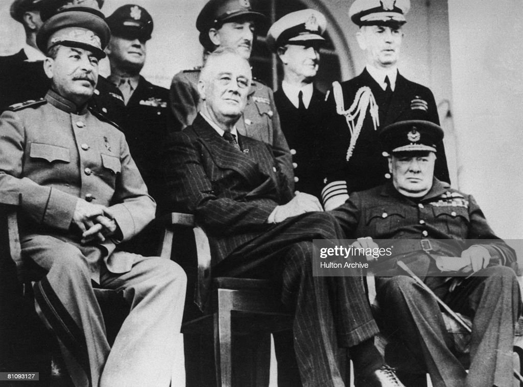 Political and military leaders attend the Tehran Conference during World War II December 1943 From left to right Joseph Stalin Franklin D Roosevelt...