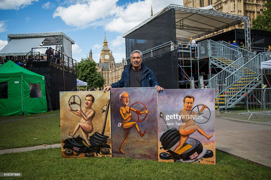 Political artist Kaya Mar poses for a photograph with his Brexit-themed artwork depicting British Chancellor George Osborne, Labour Leader Jeremy Corbyn and British Prime Minister David Cameron all holding steering wheels on June 27, 2016 in London, England. British Prime Minister David Cameron chaired an emergency Cabinet meeting this morning, after Britain voted in a referendum to leave the European Union. Various members of Labour's shadow cabinet have today quit over an apparent lack of confidence in Jeremy Corbyn's leadership of the party during the referendum campaign.