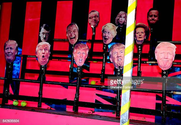 Political coconut shy featuring Donald Trump Boris Johnson Nigel Farage David Cameron and Adolf Hitler at Glastonbury Festival 2016 at Worthy Farm...