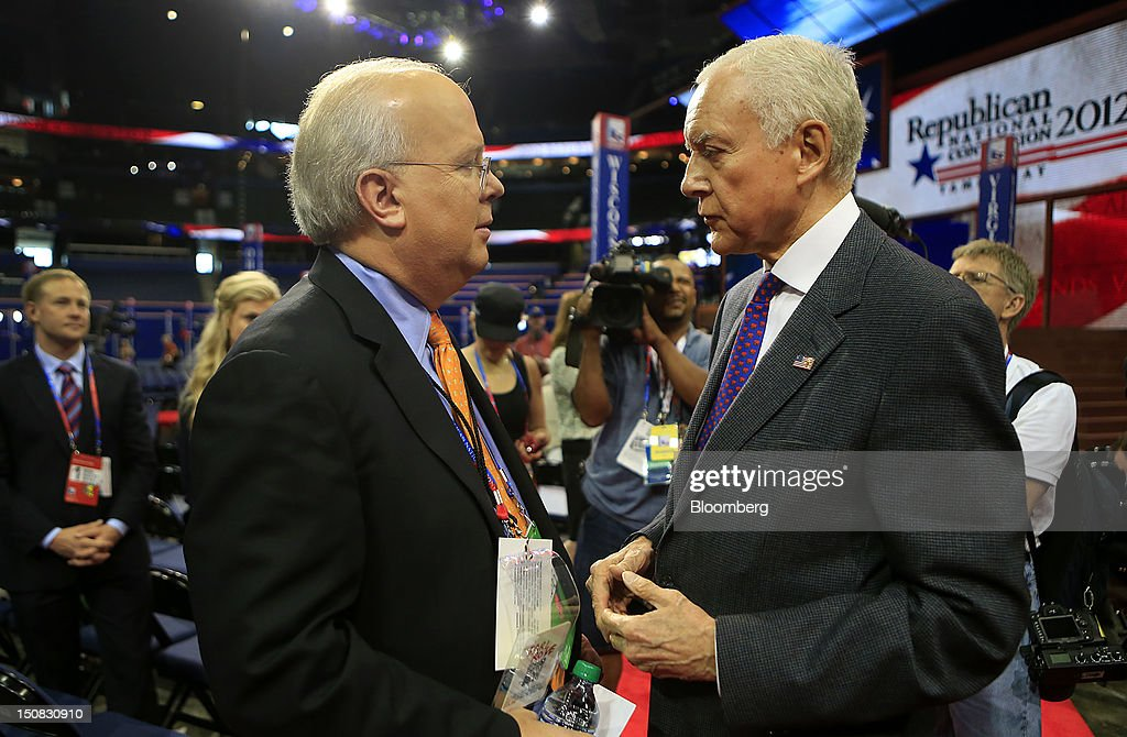 Political consultant <a gi-track='captionPersonalityLinkClicked' href=/galleries/search?phrase=Karl+Rove&family=editorial&specificpeople=206953 ng-click='$event.stopPropagation()'>Karl Rove</a>, left, speaks with Senator Orrin Hatch, a Republican from Utah, at the Republican National Convention (RNC) in Tampa, Florida, U.S., on Monday, Aug. 27, 2012. The first day of the RNC is formally convening on Aug. 27 and then immediately recessing until Aug. 28 due to Tropical Storm Isaac. Photographer: Andrew Harrer/Bloomberg via Getty Images