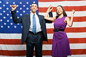Political couple cheering by American flag