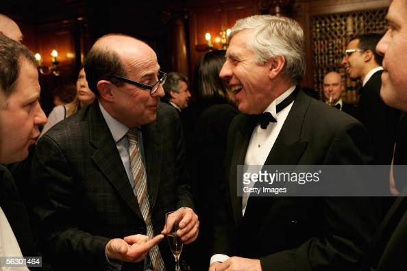 BBC political editor Nick Robinson and Britain's Foreign Secretary Jack Straw chat during the Foreign Press Association Media Awards 2005 held at the...