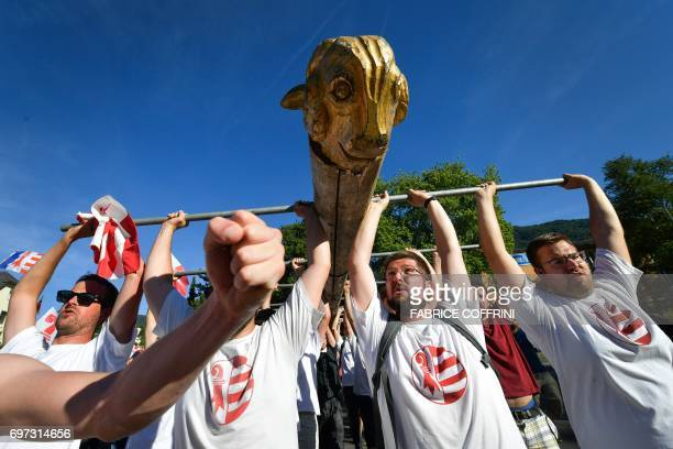 Political group raise a battering ram symbol of separatism during a demonstration after the commune of Moutier voted to join primarily Frenchspeaking...