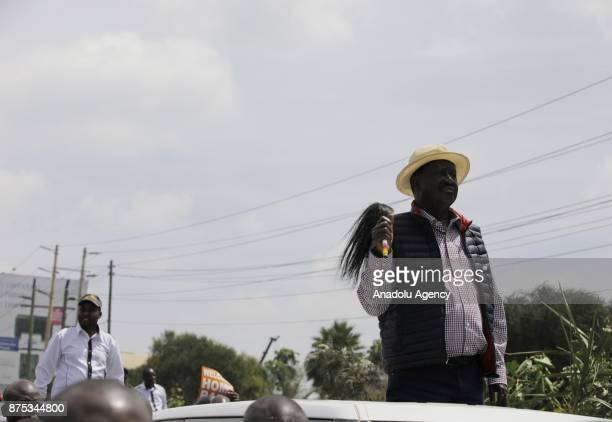 Political opposition leader Raila Odinga is welcomed by his supporters after his coming back from an overseas trip in Nairobi Kenya on November 17...