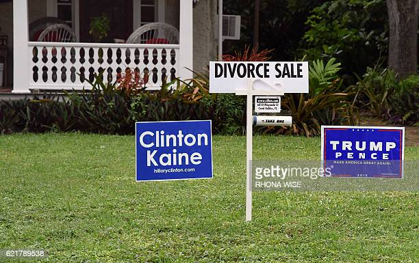 Political signs are seen with a divorce sign in front of a house in Coral Gables Florida on November 8 2016 / AFP / RHONA WISE