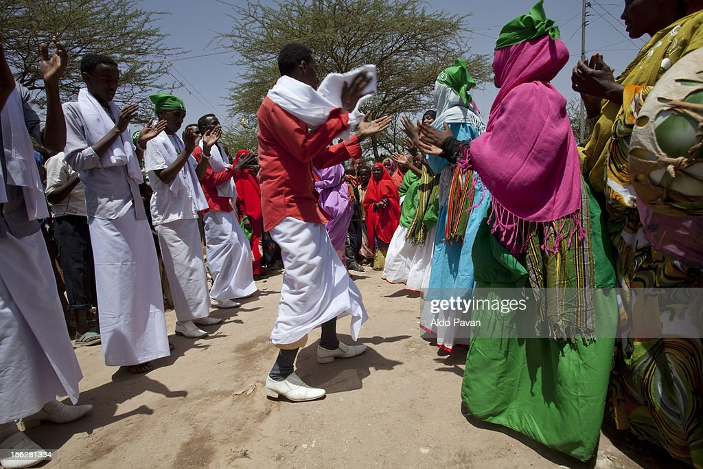Political supporters dancing and singing. : Stock Photo