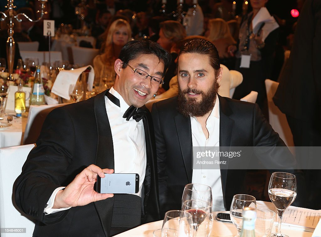 Politican Philipp Roesler and <a gi-track='captionPersonalityLinkClicked' href=/galleries/search?phrase=Jared+Leto&family=editorial&specificpeople=214764 ng-click='$event.stopPropagation()'>Jared Leto</a> attend the 21st UNESCO Charity Gala 2012 on October 27, 2012 in Dusseldorf, Germany.