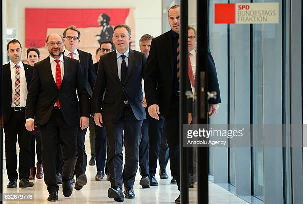 SPD politician and designated party's chairman Martin Schulz and German Social Democrats Bundestag faction leader Thomas Opperman attend a faction...
