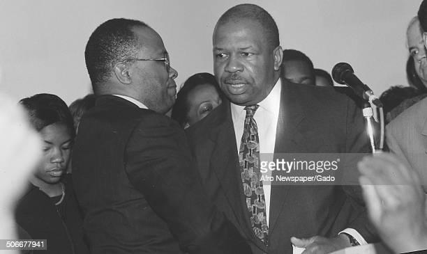 Politician and Maryland congressional representative Elijah Cummings conversing 1994