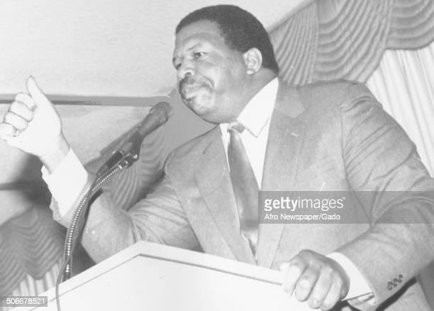 Politician and Maryland congressional representative Elijah Cummings speaking at a podium 1994