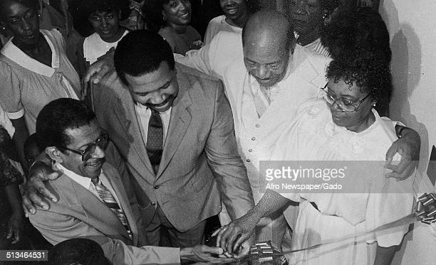 Politician and Maryland congressional representative Elijah Cummings Norman Ron and Charlene Blount during a ceremony June 1984