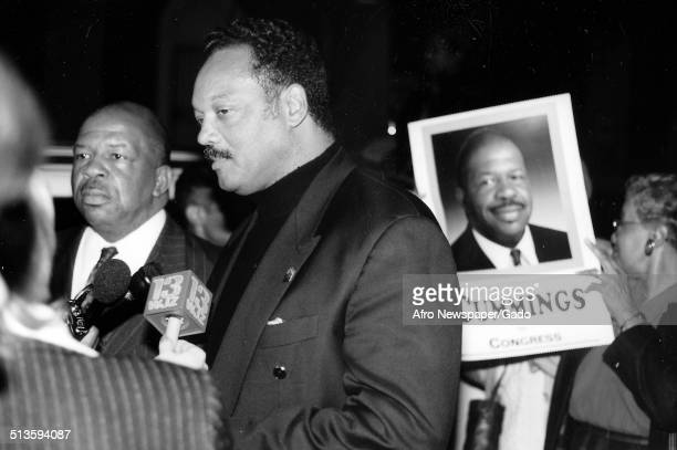 Politician and Maryland congressional representative Elijah Cummings and politician civil rights activist and preacher the Reverend Jesse Jackson...