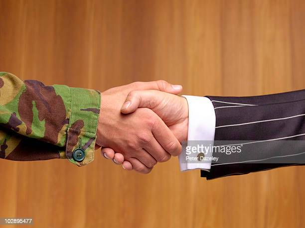 Politician and soldier shaking hands