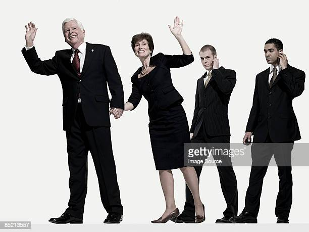 Politician and wife with bodyguards