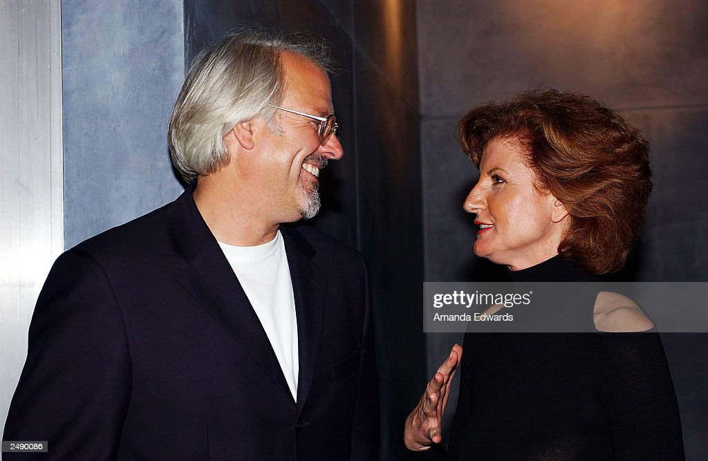 Politician Arianna Huffington (R) hats with William Turner at the Santa Monica Museum of Art's Party with Frank Gehry at Chuck Arnoldi's art studio on September 12, 2003 in Venice, California.