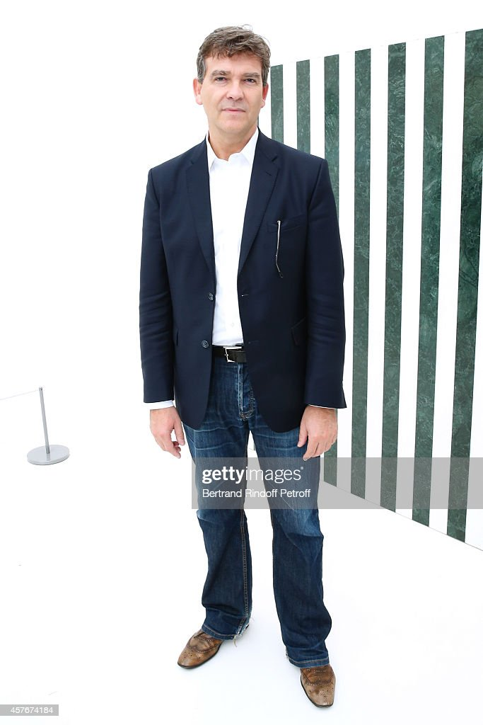 Politician Arnaud Montebourg poses front of a Buren work during the FIAC 2014 - International Contemporary Art Fair - : Official Opening at Le Grand Palais on October 22, 2014 in Paris, France.