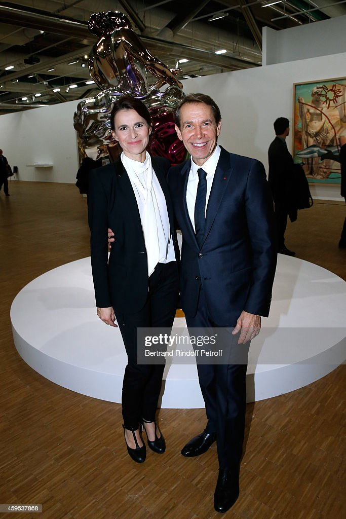 Politician Aurelie Filippetti and artist Jeff Koons attend the 'Jeff Koons' Retrospective Exhibition : Opening Evening at Beaubourg on November 24, 2014 in Paris, France.