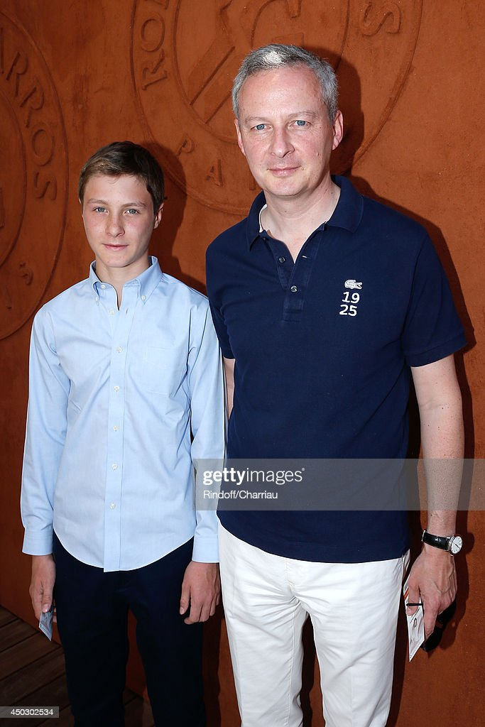 Politician <a gi-track='captionPersonalityLinkClicked' href=/galleries/search?phrase=Bruno+Le+Maire&family=editorial&specificpeople=877418 ng-click='$event.stopPropagation()'>Bruno Le Maire</a> and his son Louis attend the Men's Final of Roland Garros French Tennis Open 2014 - Day 15 on June 8, 2014 in Paris, France.