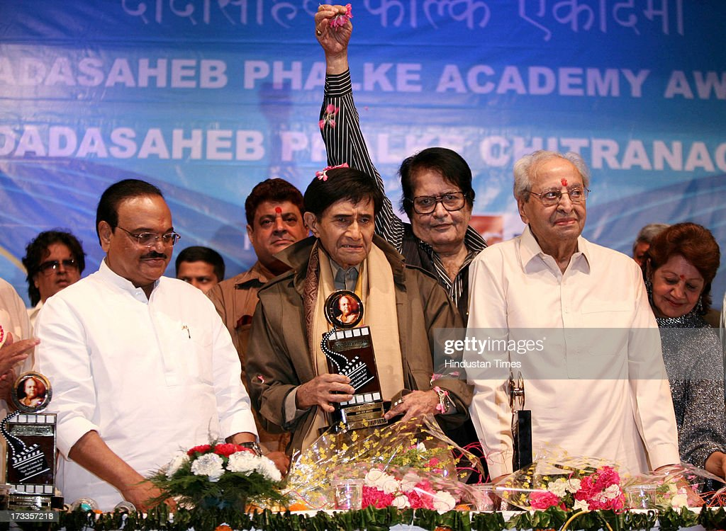 Politician Chaggan Bhujbal, Dev Anand, Manoj Kumar and Pran at the felicitation of Dev Anand on Dadasaheb Phalke Awards Ceremony at Bhaidas Hall, Vile Parle on April 30, 2010 in Mumbai, India. Veteran Bollywood actor Pran, who made a mark for himself portraying strong negative and supporting roles, passed away at the age of 93 on Friday evening after prolonged illness. Born on February 12, 1920, Pran has been known for remarkable roles in Bollywood hits like Zanjeer, Don, Amar Akbar Anthony, Upkaar, Parichay and Sharaabi among hundreds others.
