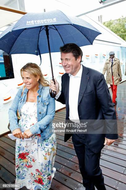 Politician Christian Estrosi and his companion journalist Laura Tenoudji attend the 2017 French Tennis Open Day Ten at Roland Garros on June 6 2017...