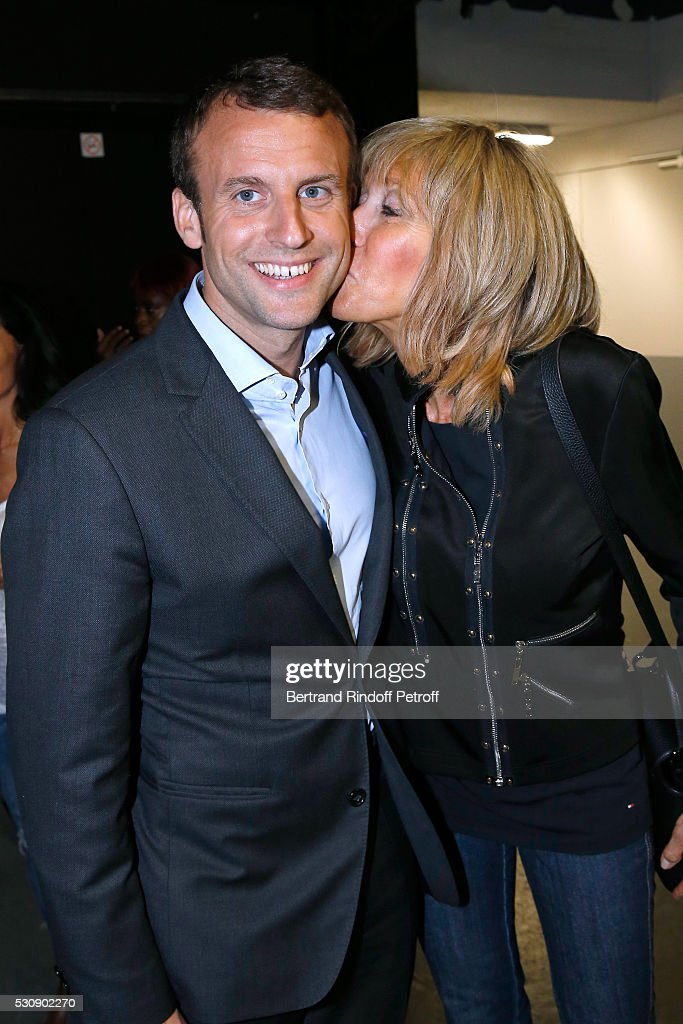 Politician <a gi-track='captionPersonalityLinkClicked' href=/galleries/search?phrase=Emmanuel+Macron&family=editorial&specificpeople=9899223 ng-click='$event.stopPropagation()'>Emmanuel Macron</a> and his wife Brigitte attend Michel Polnareff performs at AccorHotels Arena Bercy : Day 4 on May 11, 2016 in Paris.