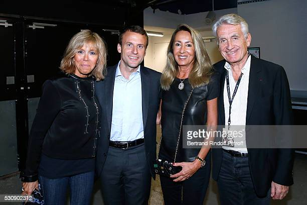 Politician Emmanuel Macron his wife Brigitte producters Gilbert Coullier and his wife Nicole attend Michel Polnareff performs at AccorHotels Arena...