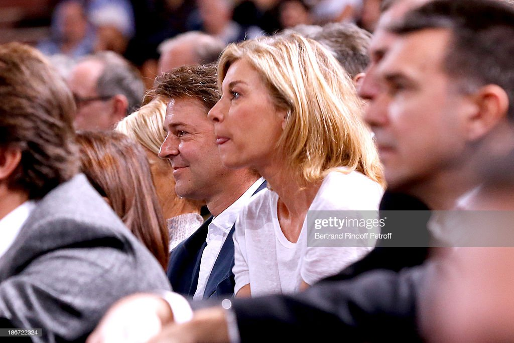 Politician <a gi-track='captionPersonalityLinkClicked' href=/galleries/search?phrase=Francois+Baroin&family=editorial&specificpeople=552822 ng-click='$event.stopPropagation()'>Francois Baroin</a> (CL) and actress <a gi-track='captionPersonalityLinkClicked' href=/galleries/search?phrase=Michele+Laroque&family=editorial&specificpeople=593269 ng-click='$event.stopPropagation()'>Michele Laroque</a> (CR) attend the final of the BNP Paribas Tennis Masters - day seven, at Palais Omnisports de Bercy on November 3, 2013 in Paris, France.