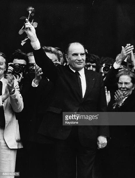 Politician Francois Mitterand raising a rose in the air in victory as the new President of France at the Pantheon Paris 1981