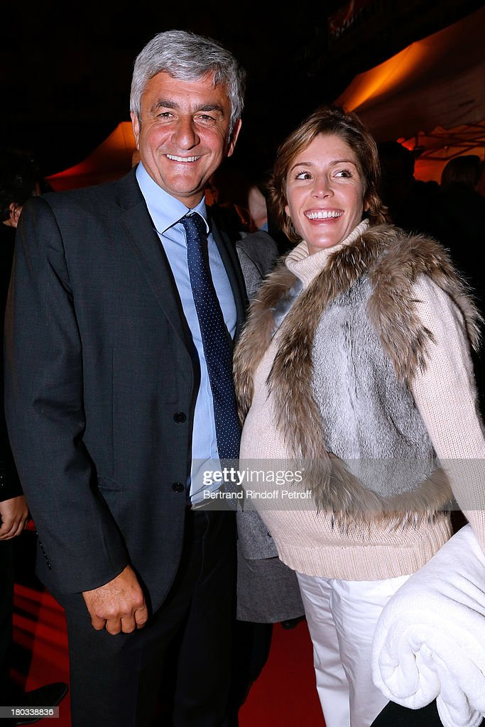 Politician Herve Morin with wife Elodie attend 'Opera En Plein Air' : Gala with 'La flute enchantee' by Mozart play at Hotel Des Invalides on September 11, 2013 in Paris, France.