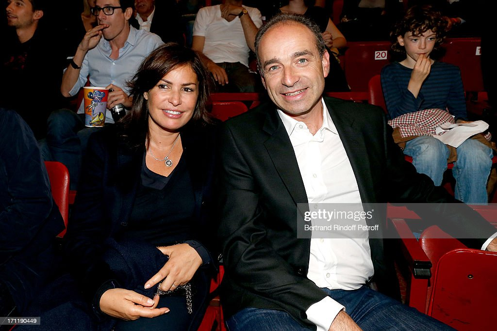 Politician Jean-Francois Cope (R) and his wife in the stand during Patrick Bruel's last concert in Paris, held at Palais Omnisports de Bercy on June 22, 2013 in Paris, France.