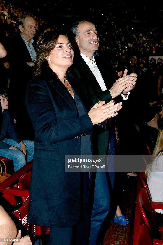 Politician Jean-Francois Cope (R) and his wife in the stand while Patrick Bruel performs at his last concert in Paris, held at Palais Omnisports de Bercy on June 22, 2013 in Paris, France.