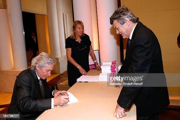 Politician JeanLouis Borloo and JeanPaul Moureau attend the JeanPaul Moureau book signing for 'Soigner Autrement' at Hotel Park Hyatt Paris Vendome...