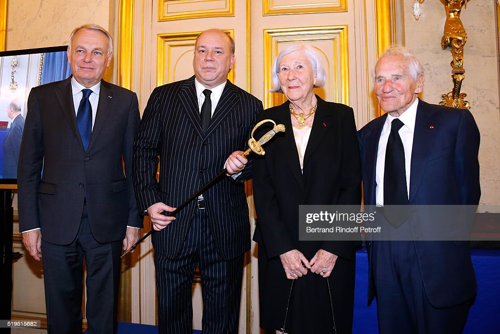 Politician Jean-Marc Ayrault, Marc Lambron, President of the sword Committee, Miss Claude Levi and Academician Jean d'Ormesson attend writer Marc Lambron receives 'L'Epee d'Academicien' of 'Academie Francaise' on April 6, 2016 in Paris, France.