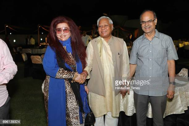 Politician Kariya Munda and Shahnaz Husain CEO of Shahnaz Herbals Inc during the screening of a biography based on Munda's life a tribute to tribal...