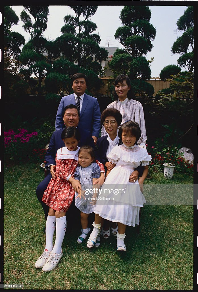 Politician Kim Dae-jung (seated) joins his family in South Korea. Kim was elected president of South Korea in 1997, and won the Nobel Peace Prize in 2000.