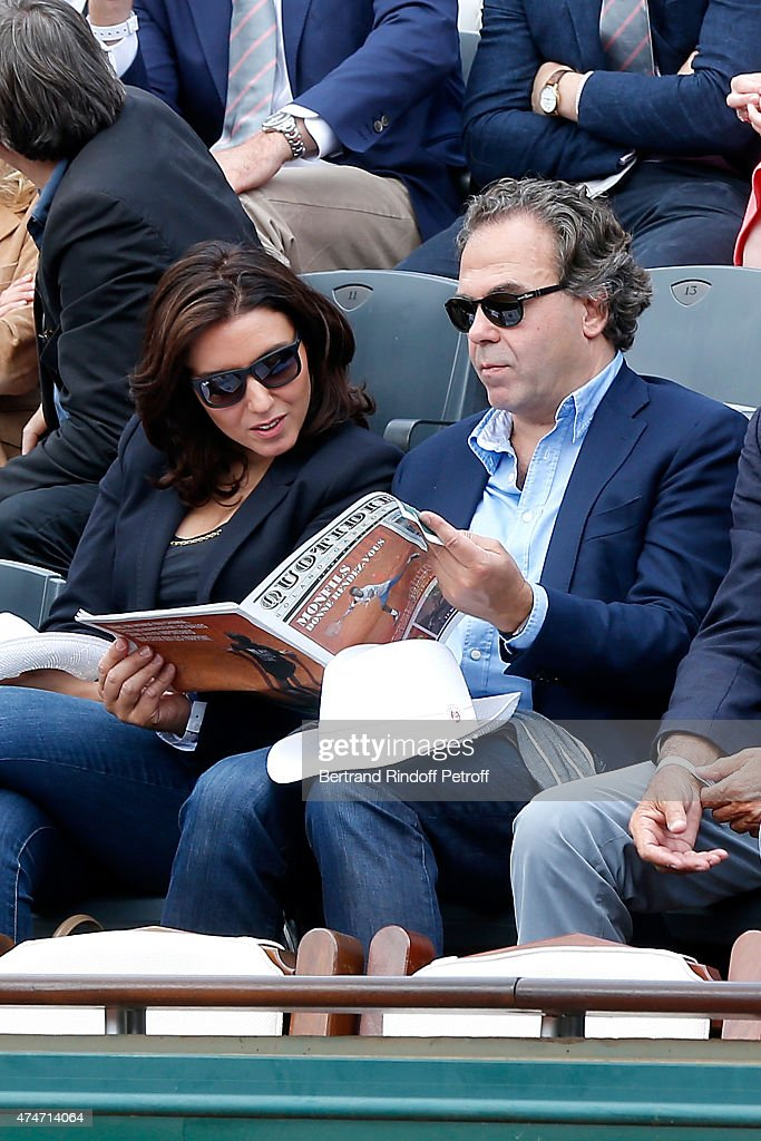 Politician Luc Chatel and his companion Mahnaz Hatami attend the 2015 Roland Garros French Tennis Open - Day 2, on May 25, 2015 in Paris, France.