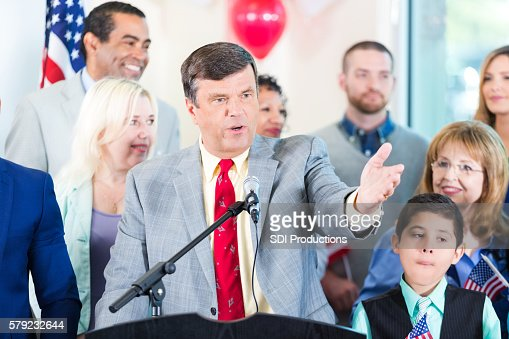 Politician making speech with supporters