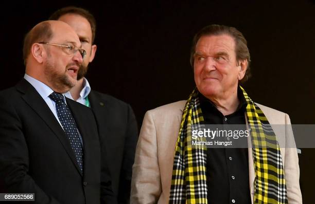 SPD politician Martin Schulz and former chancellor of Germany Gerhard Schroeder look on prior to the DFB Cup Final 2017 between Eintracht Frankfurt...