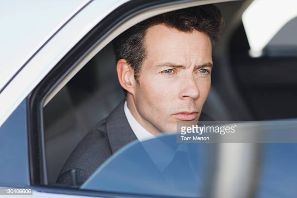 Politician peering out car window