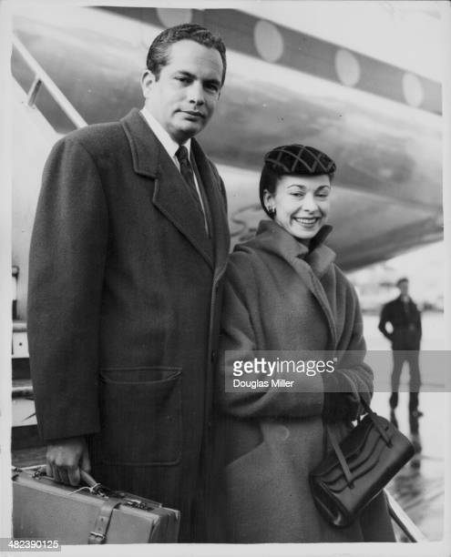 Politician Roberto Arias with his wife British ballerina Dame Margot Fonteyn photographed by the press as they leave their plane at London Airport...