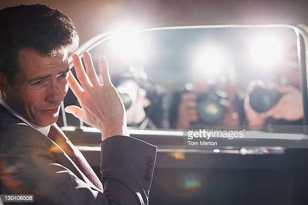 Politician shielding himself from paparazzi