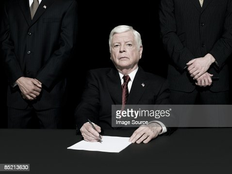 Politician signing paper : Stock Photo
