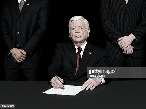 Politician signing paper