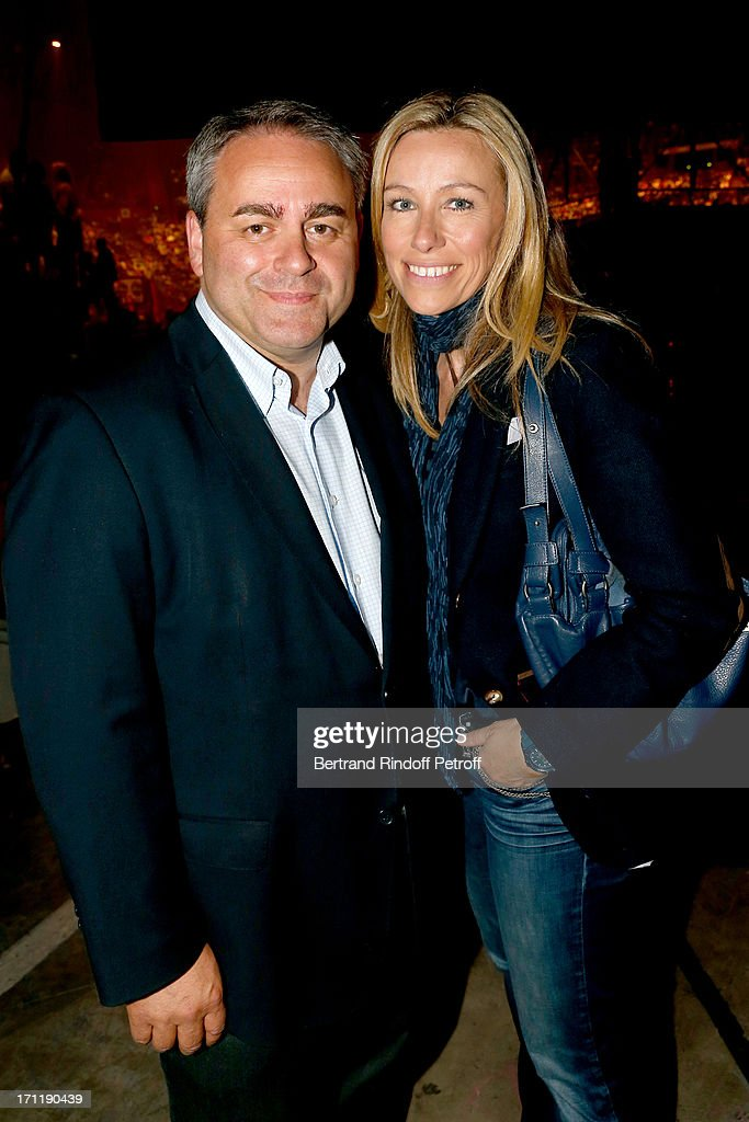 Politician Xavier Bertrand and his wife in the stand during Patrick Bruel's last concert in Paris, held at Palais Omnisports de Bercy on June 22, 2013 in Paris, France.